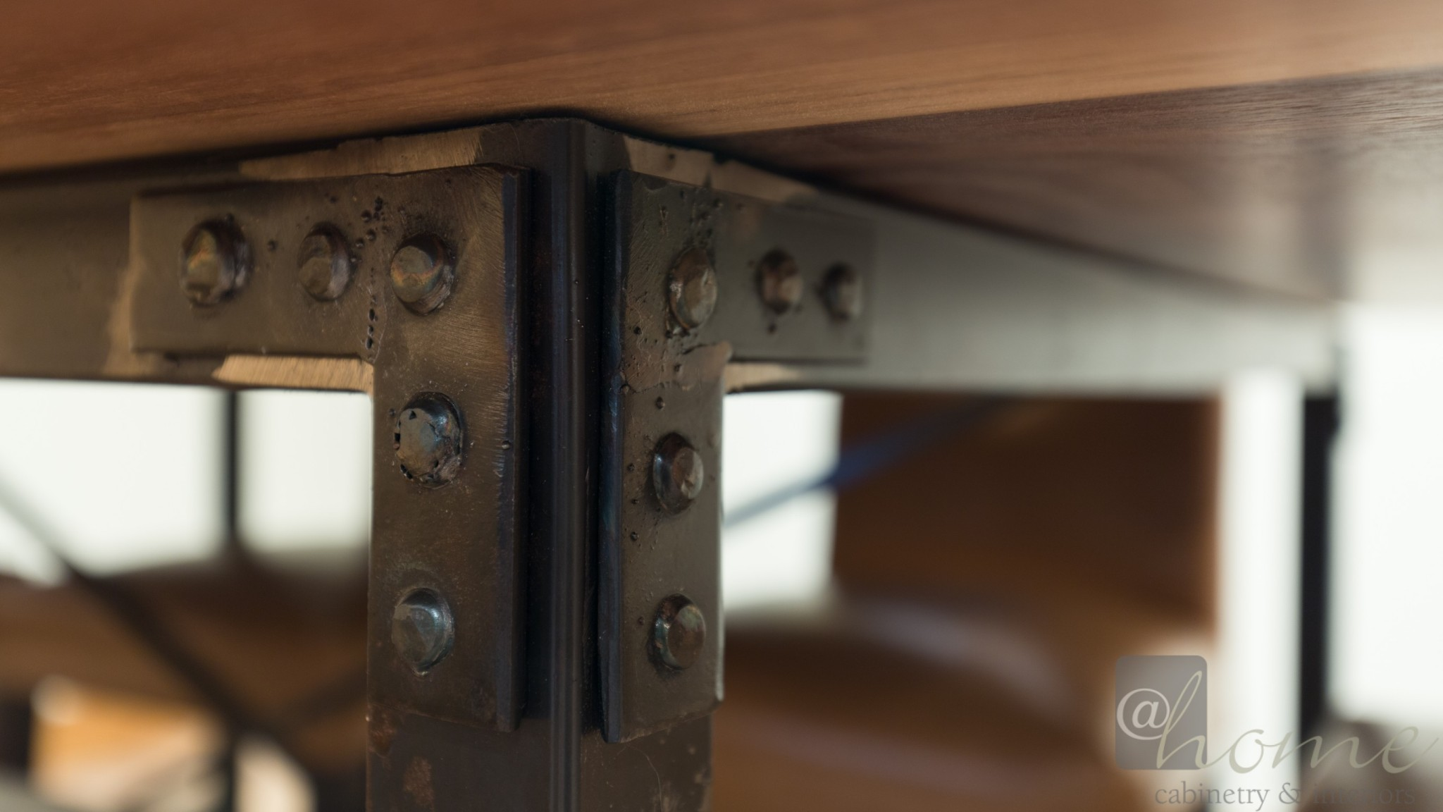 We designed the base & contracted a local metal smith to fabricate. The top is natural walnut with light distressing.